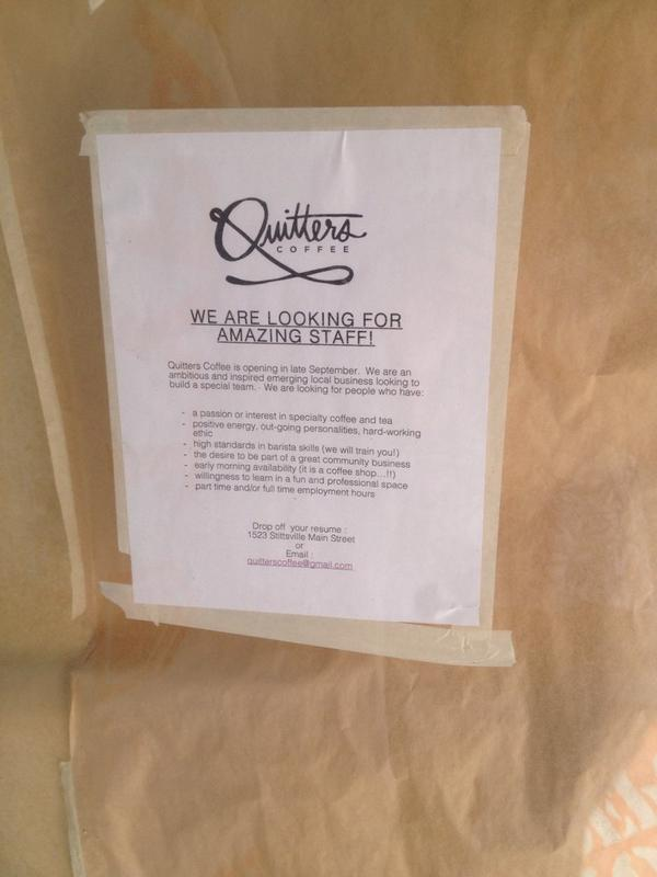 Sign posted on the front of Quitters on Main Street.