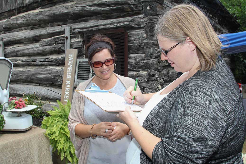 STITTSVILLE, ON, August 14, 2016. Stittsville Assocation President Tanya Hein signs the petition help organize a farmers market at the barn in the Village Square. Barry Gray (StittsvilleCentral)