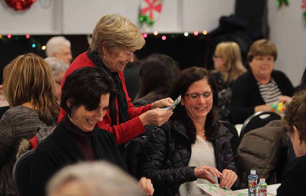 STITTSVILLE, ON. December 16. 2015. Smiling winners get their cash on early bingo winning cards. Barry Gray (For StittsvilleCentral).