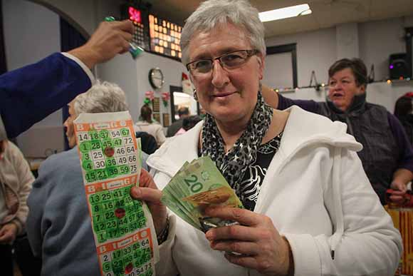 STITTSVILLE, ON. December 16. 2015. The last winner of bingo at the Stittsville Legion, Diane Statham with her card and winnings. Barry Gray (For StittsvilleCentral).