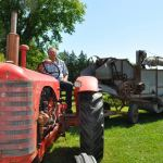 Challenging two Guinness World Records with threshing machines and a cancer pink ribbon