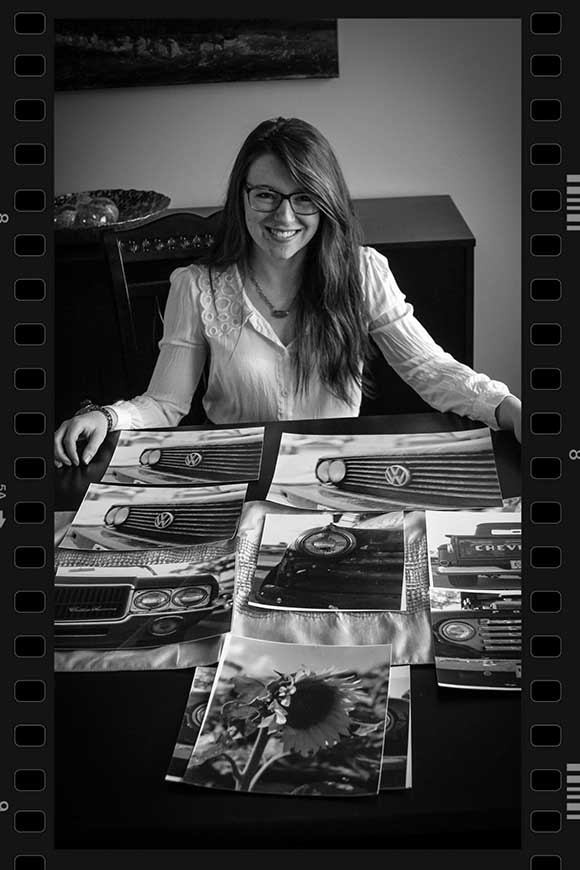 Kristin Davis with some of her black and white photos. Photo by Barry Gray