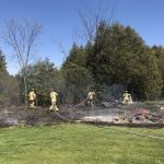 Firefighters douse 50-foot tall grass fire near Stittsville