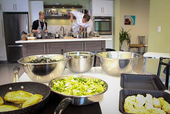 Sous chef Alana Thomson and Chef Philip Munk in the Healthy Balance kitchen with healty foods that have been prepared. Photo by Barry Gray