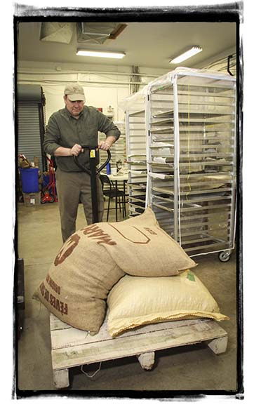 ALMONTE, ON. March 3, 2015.   Drewe Glmour with bags of beans. (Photo by Barry Gray/For StittsvilleCentral.ca)