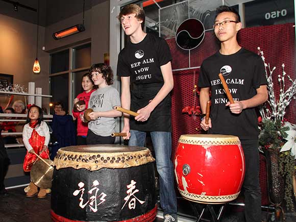 Drumming in the lions to celebrate Chinese New Year. Photo by Barry Gray.