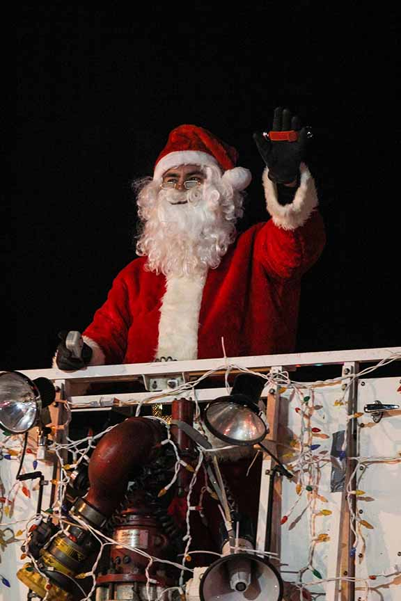 Santa arrived in the basket of the Stittsville Fire Department's Ladder 81. Barry Gray (For StittsvilleCentral).