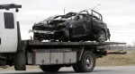 An Infiniti-brand car involved in a fatal early morning single-vehicle collision on Fallowfield Rd. at Eagleson Rd. is removed from the scene on a flatbed truck, Sunday, April 26, 2015. Photo by Mike Carroccetto.