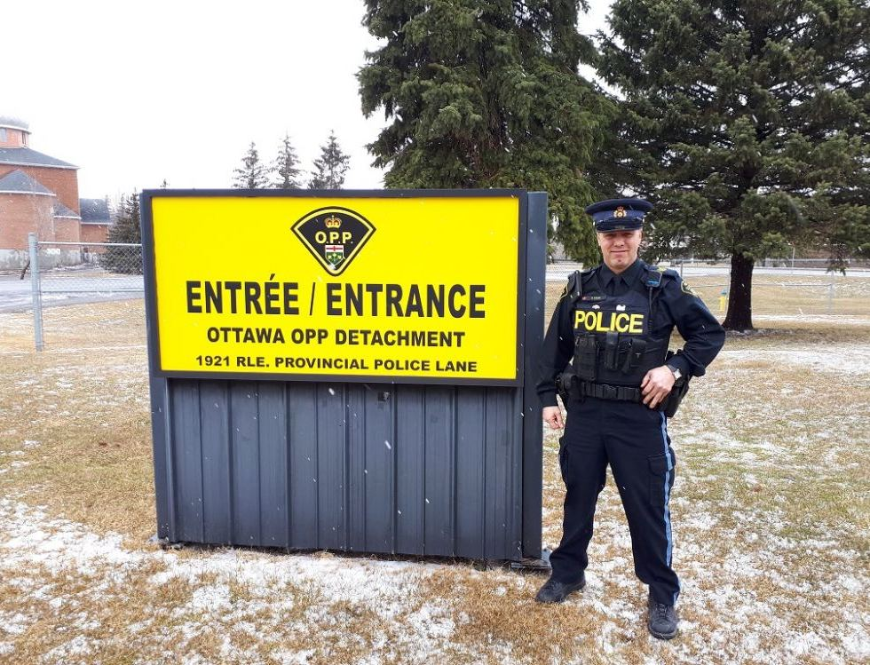 Photo: Mike Radke, retired OPP sergeant and Stittsville resident, in front of the OPP Kanata detachment. Photo via Stephanie Rudyk/SchoolBOX.