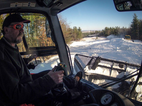 Kevin Freer operated one of two groomers out pushing the snow onto the trails.