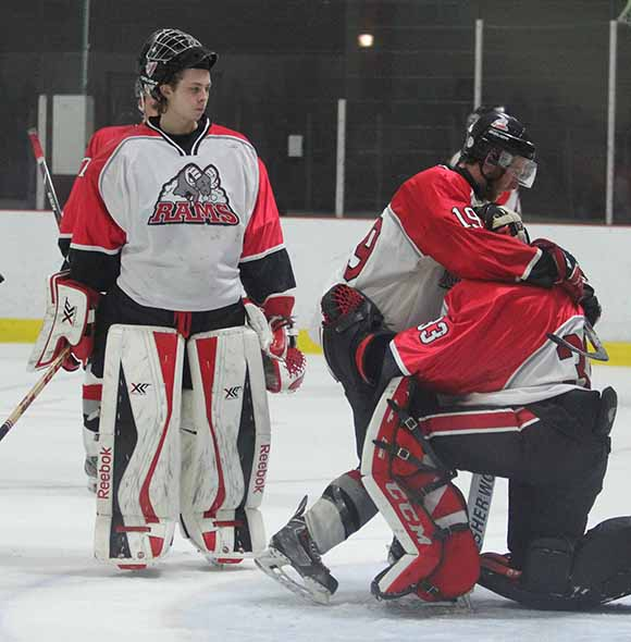 Rams Shane Hiley hugs goalie Matt Couvrette after the Ramsn were knocked out of the playoffs loosing to Casselman Vikings 8-1.  Goalie Connor Ellis who played the first half of the game looks on.