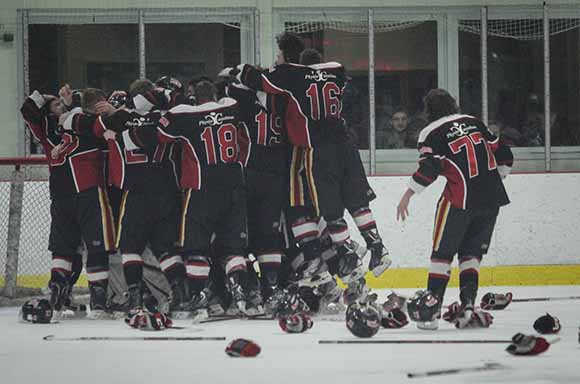 Casselman Vikings player celebrate thier EOJHL Championship win over Stittsville Rams with an 8-1 Game 6 final score.