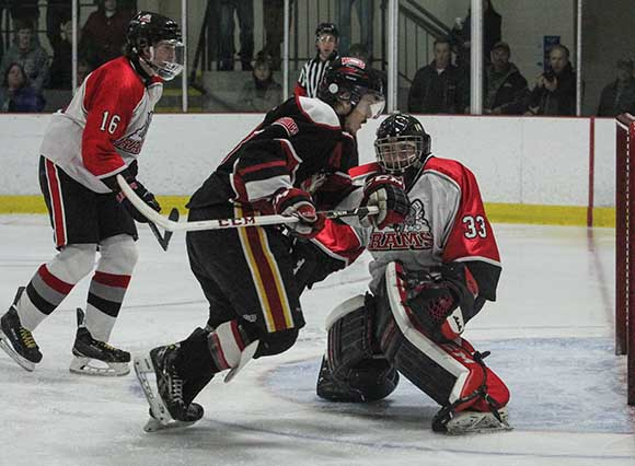 Casselman Viking player chases down the puck after Stittsville Rams goalie Matt Couvrette has made the save.   Photo by Barry Gray.