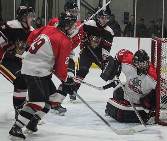 Goal mouth action as Stittsville Rams goalie Matt Couvrette make another save.   Photo by Barry Gray.