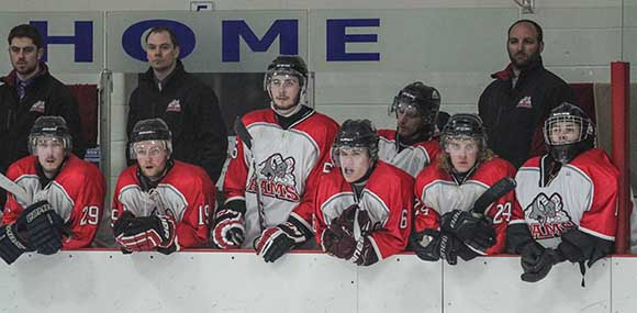 Stittsville Rams players and coaches watch the final minutes of the game.  Photo by Barry Gray.