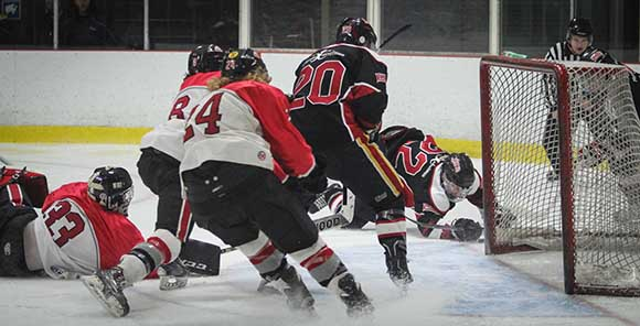 Scramble around the net as Stittsville Rams goalie Matt Couvrette is caught out of the net.   Photo by Barry Gray.