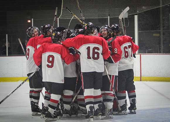 Stittville Rams players celebrate their 6-3 win over Casselman Vikings.  Photo by Barry Gray.