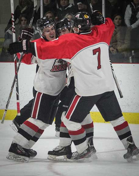 Stittsville Rams players celebrate a tieing goal midway through the first period.  Photo by Barry Gray.