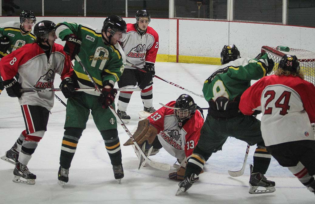 Rams goalie Matt Couvrette pounces on the puck in a goal mouth. Stittsville Rams went on to beat Arnprior Packers 4-3 in the second overtime period.