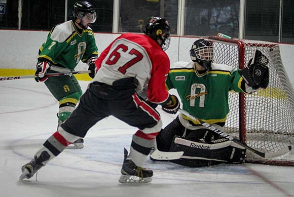 Arnprior goalie Dominic Plaschy makes a save on Rams Mitch Kerwin.