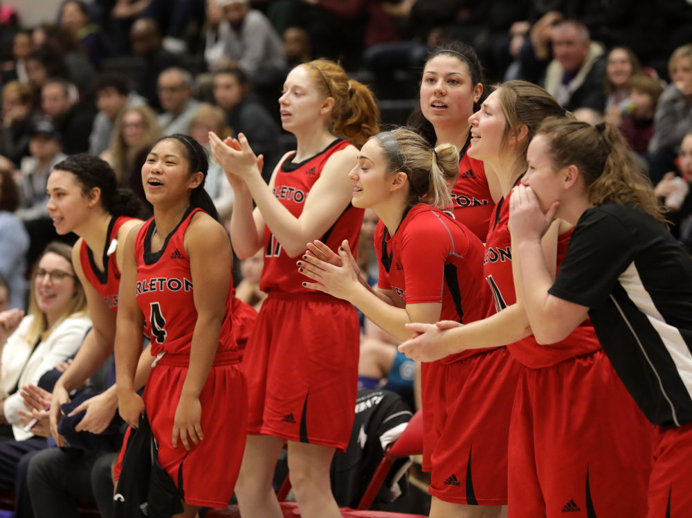 Carleton Ravens' bench celebrates basket that put them at 100 points on Saturday, January 20, 2018. Stittsville's Stephanie Carr scored 13 points to lead the Ravens to victory over the Nipissing Lakers. photo by Mike Carroccetto / for Stittsville Central
