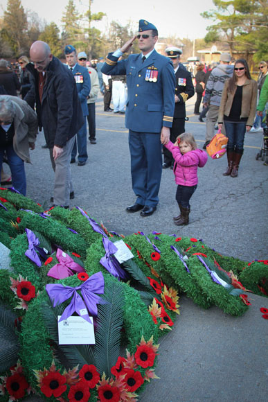 Pete Bulzphal and two year old daughter Arianne at the Remembrance Day ceremonial service. Photo by Barry Gray