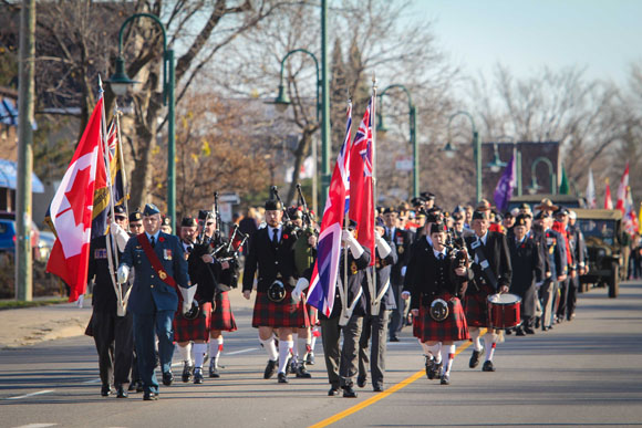 The Colour Party leads veterans and other participants down Stittsville Main Street. Photo by Barry Gray