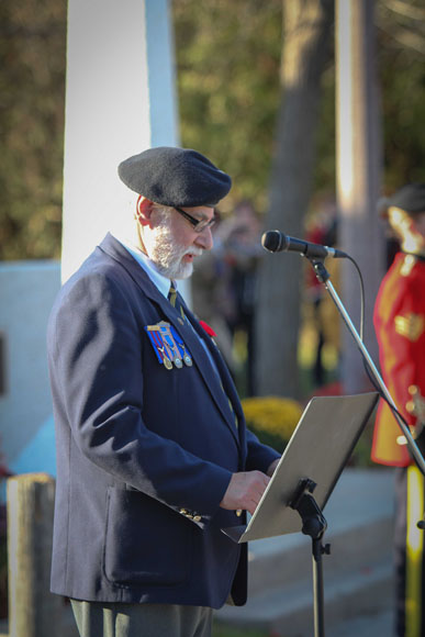 Comrade Fred Appel, President of Stittsville Legion reads opening remarks. Photo by Barry Gray