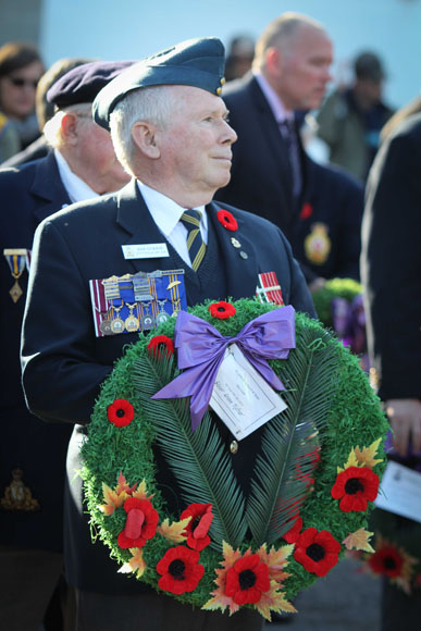 Legion member Ron Currie prepares to lay a wreath. Photo by Barry Gray