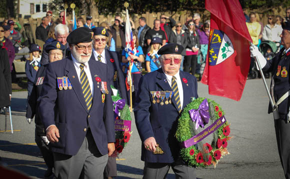 Comrade Fred Appel, President of Stittsville Legion (left) is joined by other legion members laying wreaths. Photo by Barry Gray