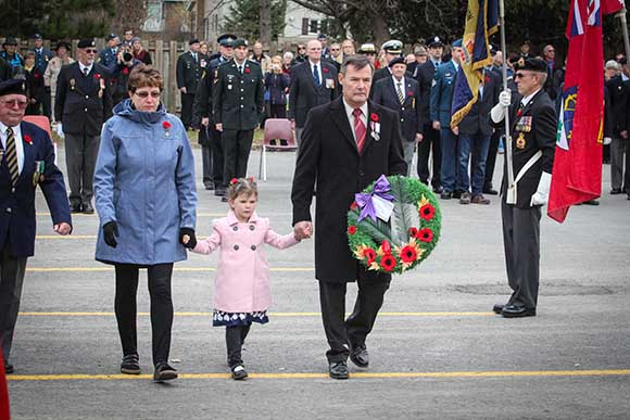 STITTSVILLE, ON. November 11, 2015. Stittsville's Silver Cross parents Claire and Richard Leger, prepare to lay a wreath with their grand daughter Samantha MacDonald. (Barry Gray/ StittsvilleCentral)