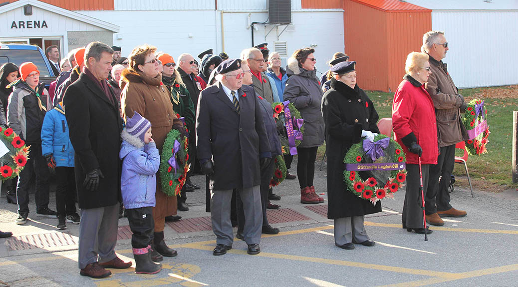 STITTSVILLE, ON. Nov.11 2016. Silver Cross Parents Richard and Claire Leger and grand daugher Samantha MacDonald (left) wait with other participants to lay wreaths at the Cenotaph in Stittsville. Barry Gray (StittsviilleCentral)