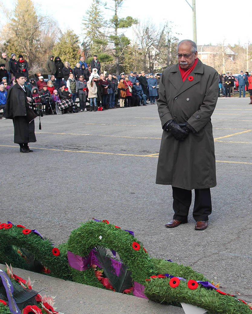 STITTSVILLE, ON. Nov.11 2016. City Councillor Shad Qadri takes a moment after placing a wreat the the Cenotaph in Stittsville. Barry Gray (StittsviilleCentral)