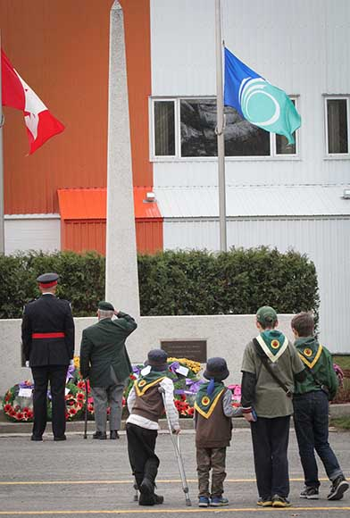 STITTSVILLE, ON, November 11, 2015. Sittsville cubs watch as wreaths are being laid at the Cenetoph. (Barry Gray /StittsvilleCentral)