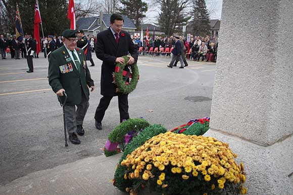 STITTSVILLE, ON. November 11 2015. Stittsville Legion member Johnny Leroux accompanies MP Pierre Polilievre as he lays a wreath at the Cenetoph. (Barry Gray / StittsvilleCentral)
