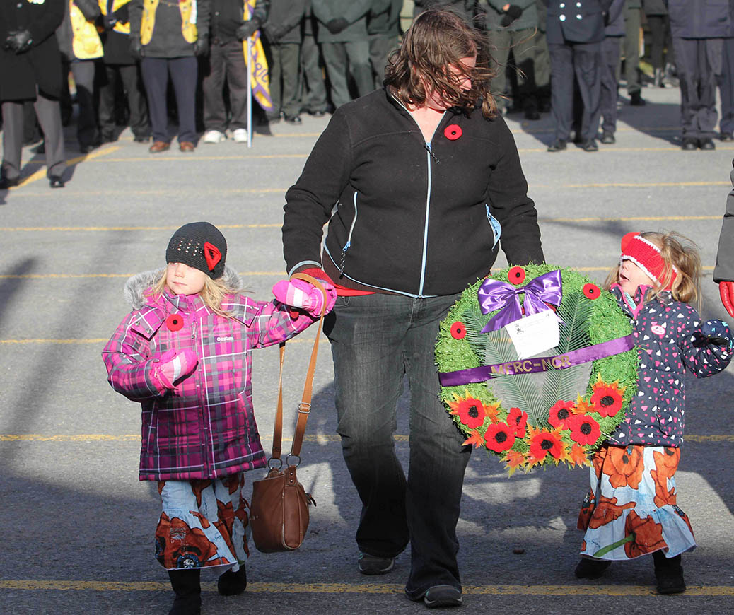 STITTSVILLE, ON. Nov.11 2016. Karen McCadden with her two children Brenna and Keira place the MFRC-NCR wreath at the Cenotaph. Barry Gray (StittsviilleCentral)