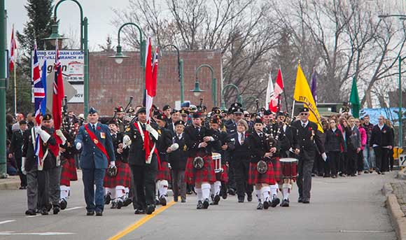 STITTSVILLE, ON. November 11 2015. Colour Party followed by Arnprior Pipe band lead the vetrans from the Legion down Main Street to the Cenetoph. (Barry Gray / StittsvilleCentral)