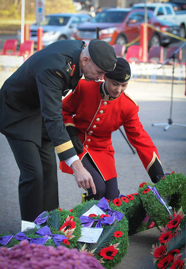 STITTSVILLE, ON. Nov.11 2016. Major General W.D. Eyre and daughter Breanna lay their popies on the wreath after the ceremonies at the Cenotaph. Barry Gray (StittsviilleCentral)