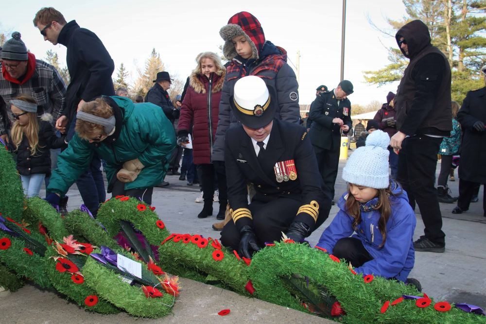 Residents lay poppies at the foot of the cenotaph.