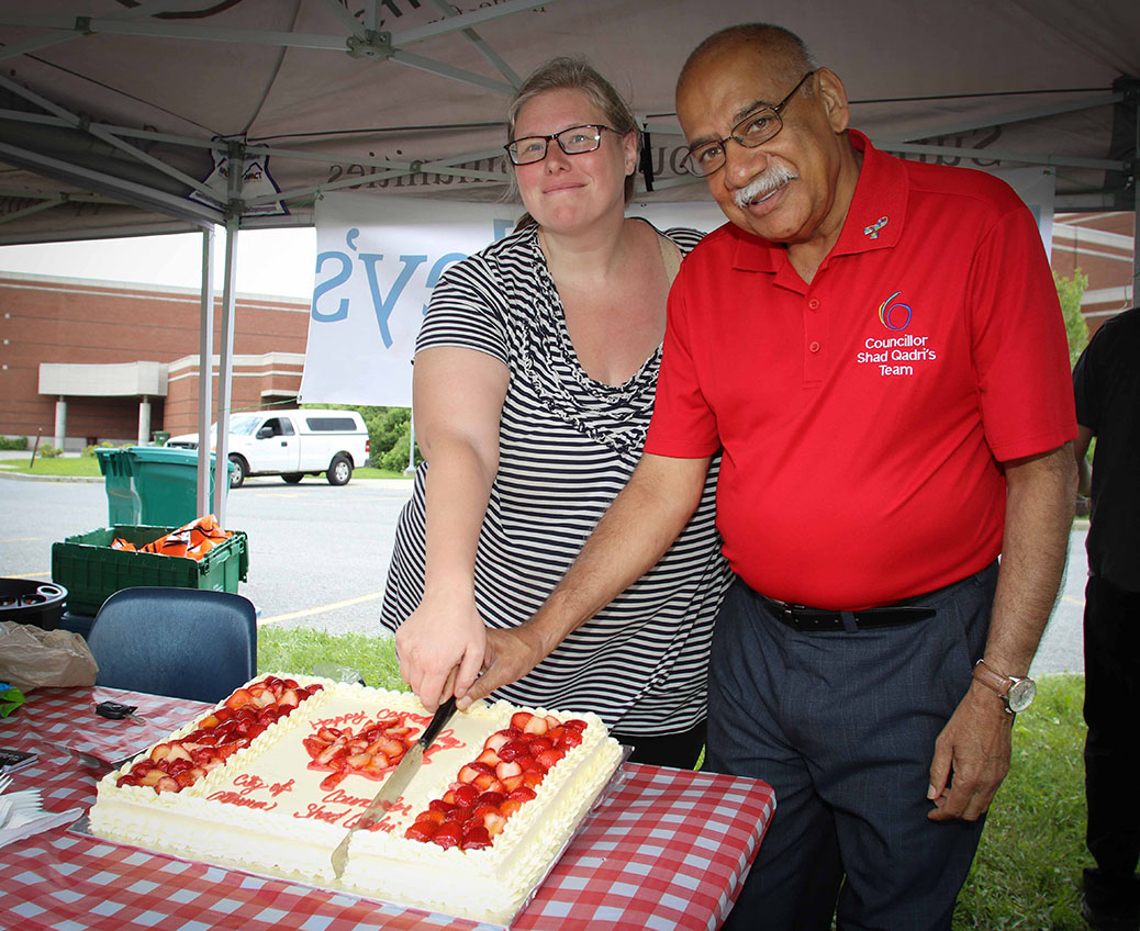 Stittsville Village Association president Tanya Hein and Councilor Shad Qadri cut the cake. Canada 2017 in Stittsville. Photo by Barry Gray.
