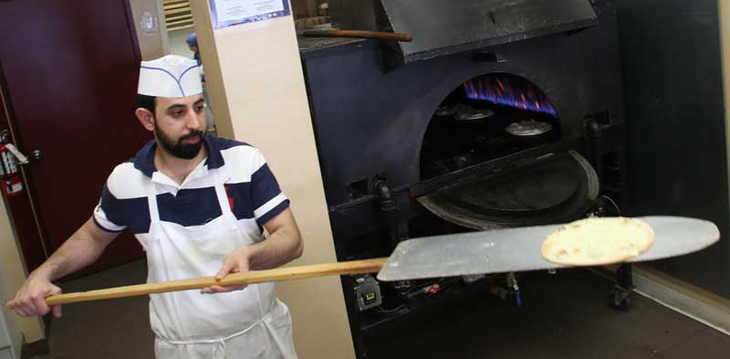 KANATA, ON, Feb.28.2018 Stittsville resident Shams Feizi takes pies out of the oven at Simbad Bakery. Barry Gray (StittsvilleCentral)