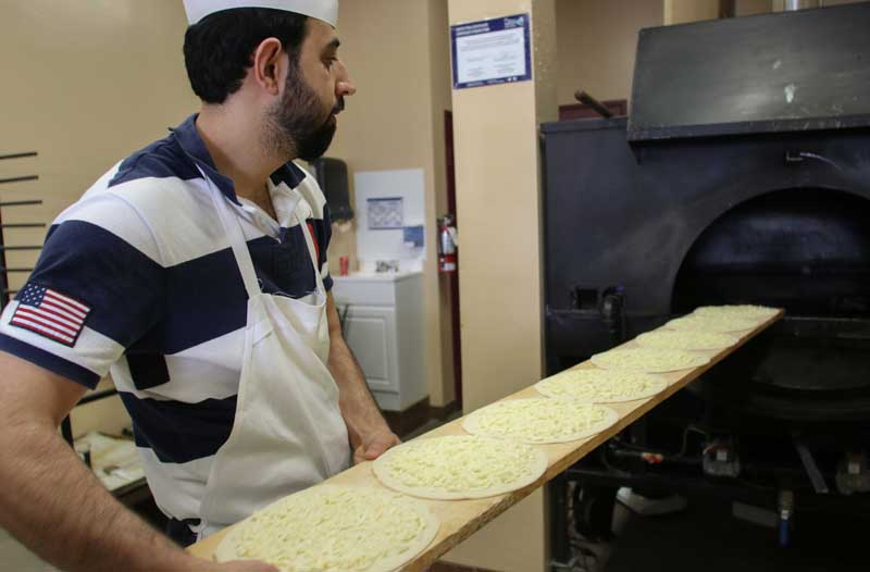 KANATA, ON, Feb.28.2018 Stittsville resident Shams Feizi puts cheese pies into the oven at Simbad Bakery. Barry Gray (StittsvilleCentral)