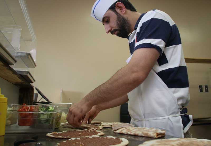 KANATA, ON, Feb.28.2018 Stittsville resident Shams Feizi prepares pies at Simbad Bakery. Barry Gray (StittsvilleCentral)
