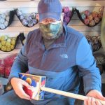 Former military engineer creates magic in the world of  the cigar box guitar