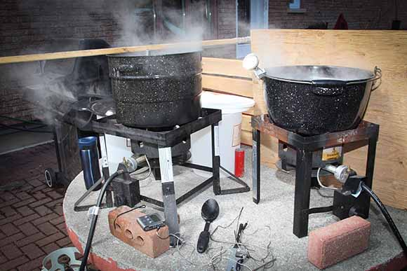 Two turkey deep fryers and a bbq are used in the process.