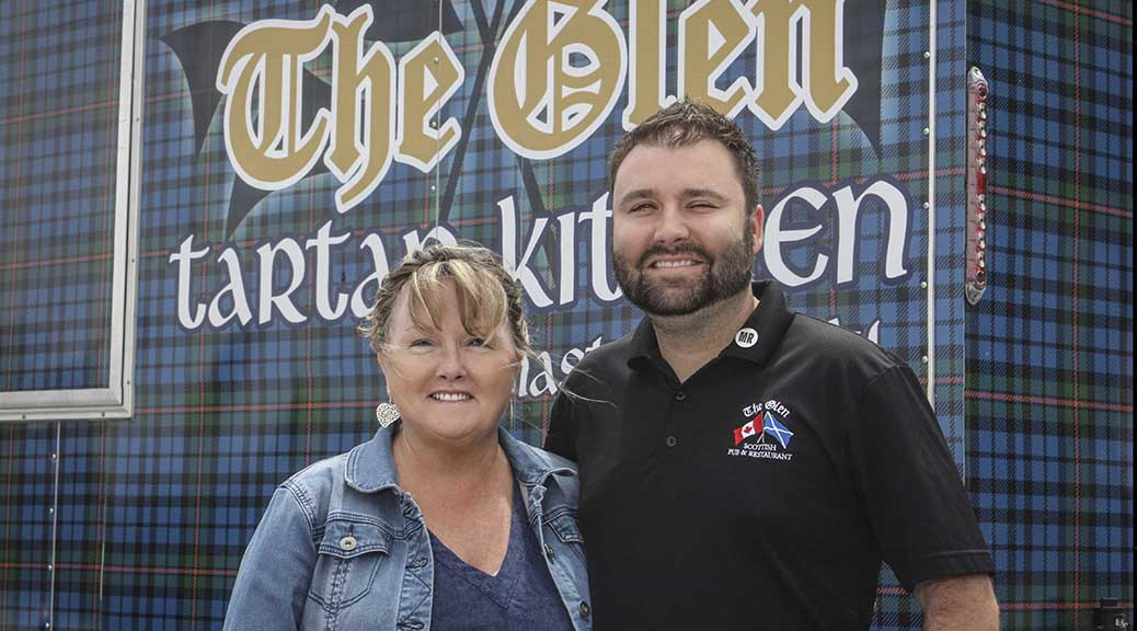 Owner of the Glen Restaurant Kathleen McConville and her son James Clarke in front of the Glen's Tartan Kitchen food truck in the parking lot at Rona on Hazeldean Road. Photo by Barry Gray.