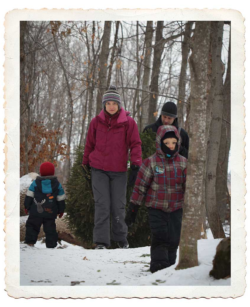 NORTH GOWER, ON. Dec 11, 2016. A family drags back their tree through the woods. Barry Gray (StittsvilleCentral)