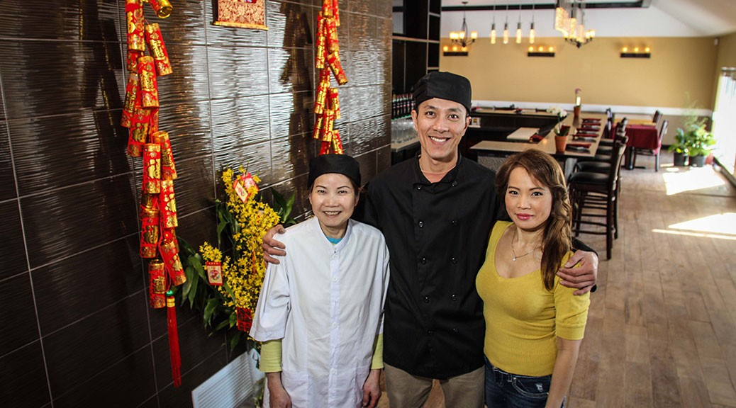 "The long-awaited ""An"" restaurant on Carp Road near Hazeldean is set to open on February 25. Taking a break from last minute preparations is Chef/Owner Cuong Tran (center) flanked by Ann Lu (left) and wife Kim Lu (right.) (Photo by Barry Gray/For StittsvilleCentral.ca)"