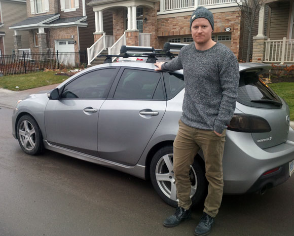 Andrew Herman stands next to his car on Maple Grove.