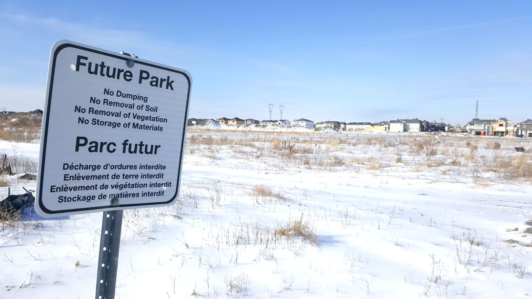 Looking west towards the future Blackstone Community Park. This sign is close to the Monahan Drain, part of the neighbourhood's stormwater infrastructure. Photo by Glen Gower.